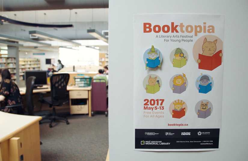 Photo of a Booktopia poster featuring all 10 cat icons on the wall in the West Van Library Youth section.