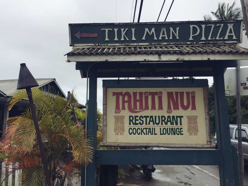 "A large free standing sign by a restaurant reading ""Tahiti Nui Restaurant Cocktail Lounge"""