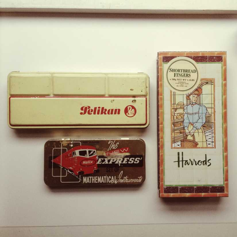 Vintage tins including a Pelikan watercolours tin, a Helix mathematical instruments tin, and a Harrods tin.