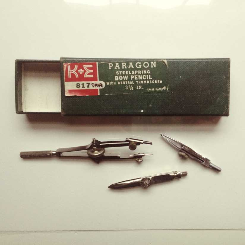 Packaging for a Paragon steelspring bow pencil and drawing compass parts below it