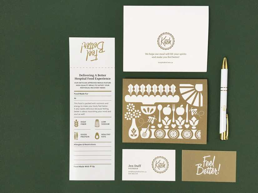 Stationery set laid out on a dark green background with postcard, food bag label, business card and pen.