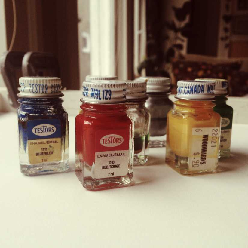 Small bottles of calligraphy ink in blue, red, yellow, and green