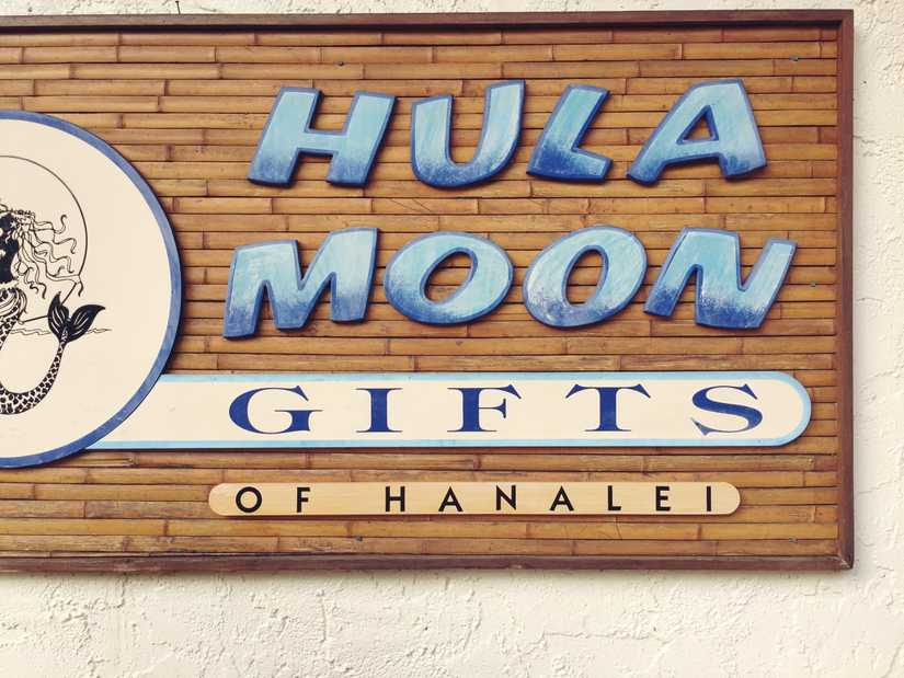 "Large wooden cut out sign that reads ""Hula Moon Gifts of Hanalei"""